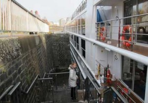 River Ship Moored next to wall in Cologne. Problems with river cruising