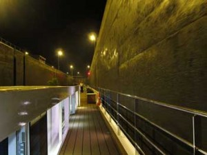 River Ship in a Lock on the Rhine at night. Problems with river cruising