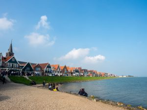 Coast line and beach with sea view in volendam, netherlands, on a springtime river cruise