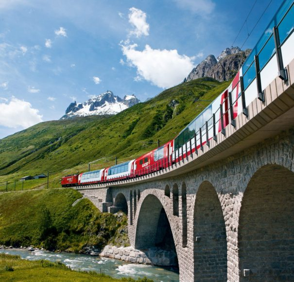 Titan Travel The Glacier Express near Hospental in the Urseren valley, Canton Uri, Central Switzerland.