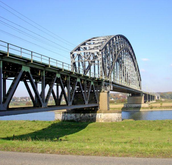 Historical railway bridge crossing the river Rhine at Oosterbee