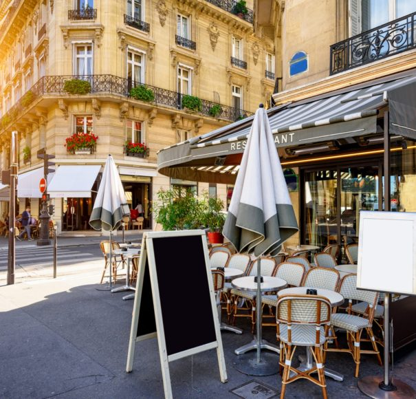Seine - Parisian-street-with-tables-of-brasserie-(cafe)-in-Paris