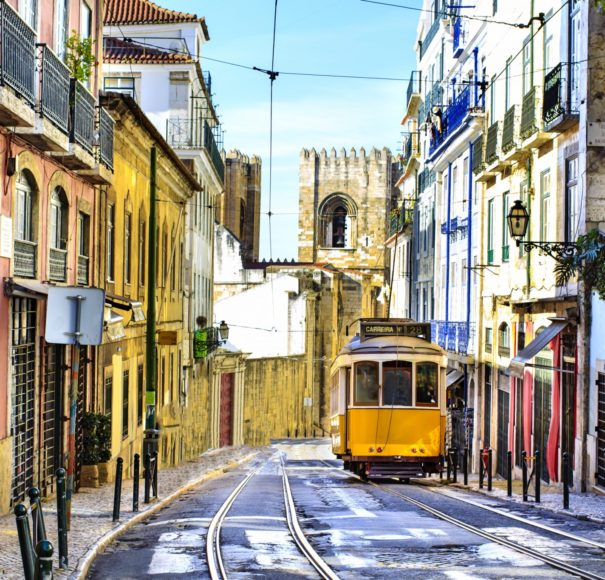 Douro -Romantic-Lisbon-street-with-the-typical-yellow-tram-and-Lisbon-Cathedral-on-the-backgroundLowRes