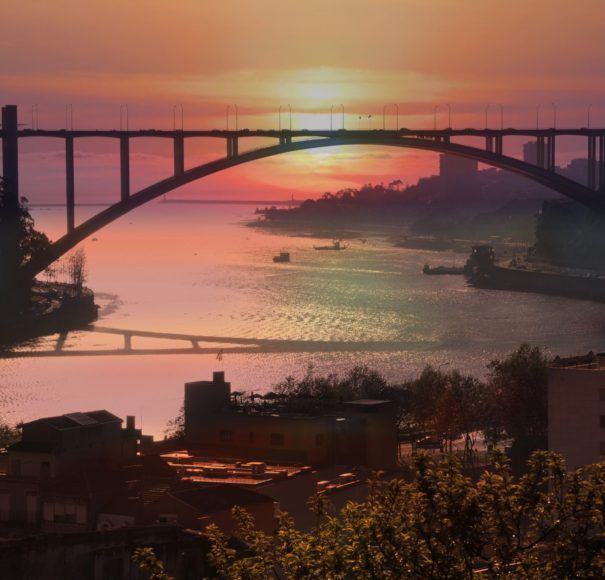 Douro -The-Arrabida-bridge-over-the-Douro-River-in-the-rays-of-the-setting-sun.-Porto,-Portugal